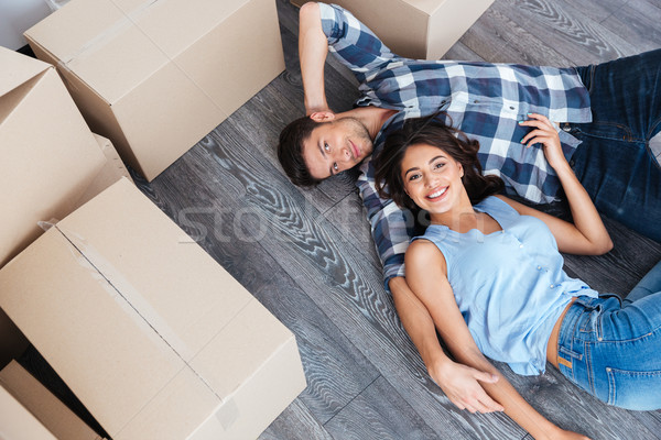Portrait of young couple moving in new home Stock photo © deandrobot