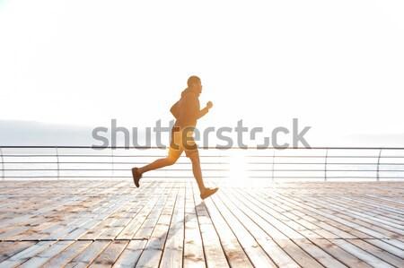 Séduisant homme courir bois terrasse africaine Photo stock © deandrobot