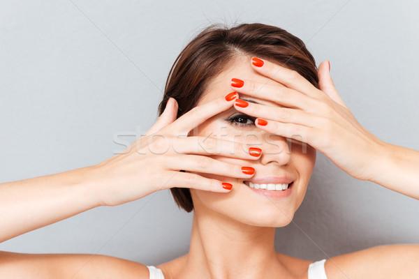 Közelkép portré nő néz ujjak mosolyog Stock fotó © deandrobot