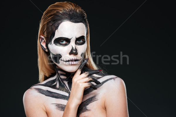 Young woman with gothic skeleton makeup Stock photo © deandrobot