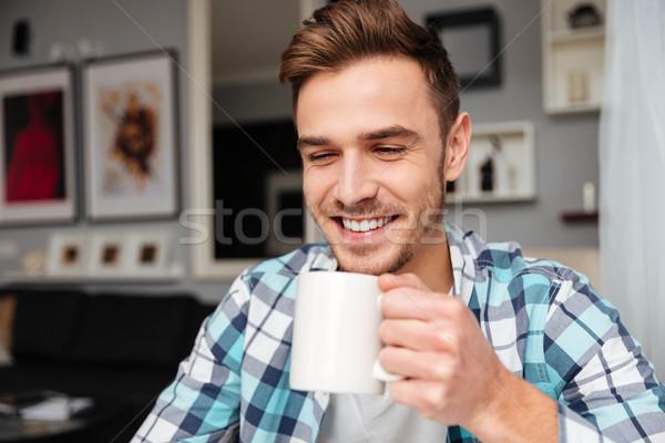 ハンサム 若い男 カップ 茶 ストックフォト © deandrobot