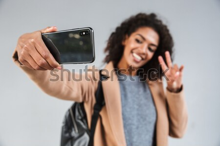 Smiling man holding and showing blank screen cell phone Stock photo © deandrobot