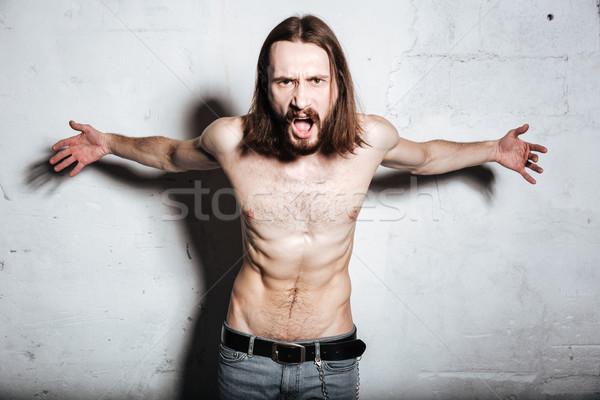 Gritando jovem barbudo homem Foto stock © deandrobot