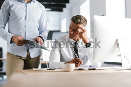 Handsome bearded businessman holding coffee and yawning Stock photo © deandrobot