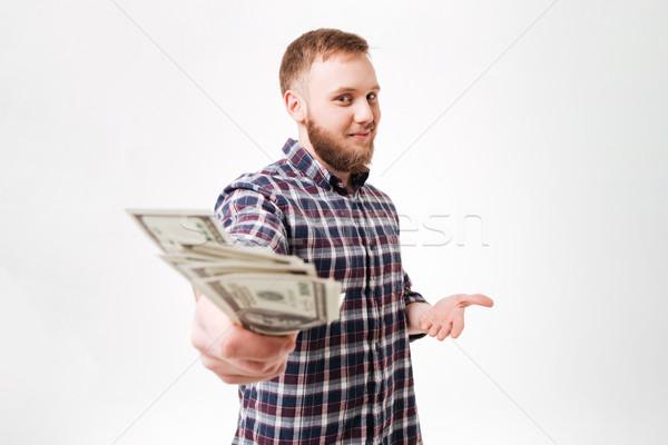Jovem barbudo homem camisas dinheiro Foto stock © deandrobot