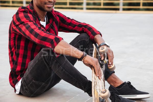 изображение молодые темно человека сидят скейтборде Сток-фото © deandrobot