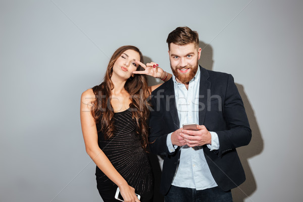 Woman in smart clothes having fun with mobile phones Stock photo © deandrobot
