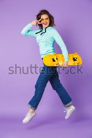 Uśmiechnięty atrakcyjna kobieta sportowiec gry tenis Zdjęcia stock © deandrobot