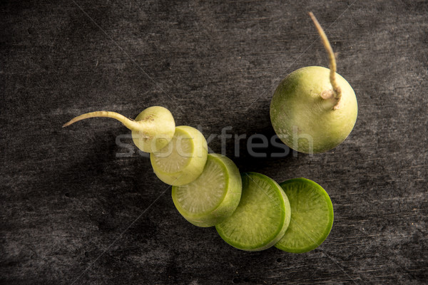 Top view image of the cut radish Stock photo © deandrobot