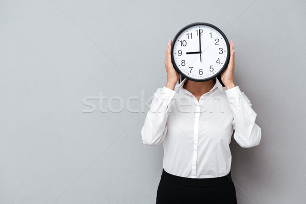 Zakenvrouw verbergen achter klok pak geïsoleerd Stockfoto © deandrobot
