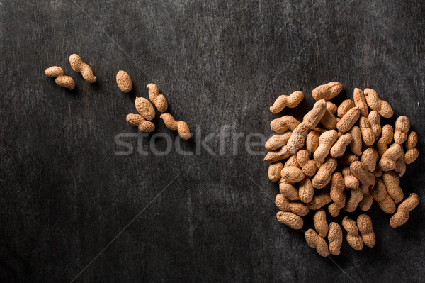 Stock photo: Dried peanut on dark background