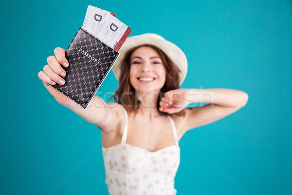Girl traveller in summer clothes showing passport with tickets Stock photo © deandrobot