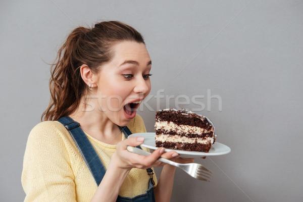 Głodny młodych kobieta w ciąży jeść Zdjęcia stock © deandrobot