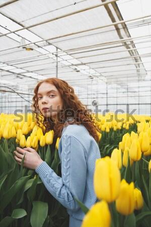 Girl enjoying flowers Stock photo © deandrobot