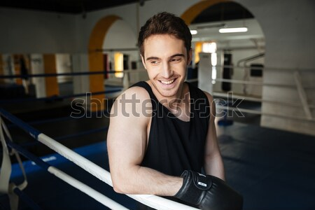 Side view of smiling boxer relaxing in boxing ring Stock photo © deandrobot