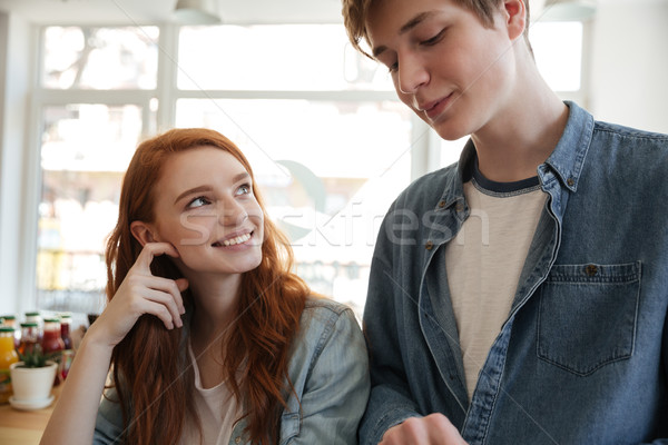 Redhead girl looking at boyfriend in cafe Stock photo © deandrobot