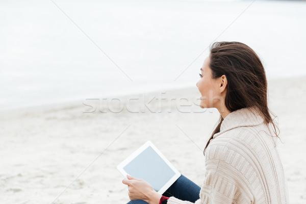 Caucásico dama sesión aire libre playa Foto stock © deandrobot