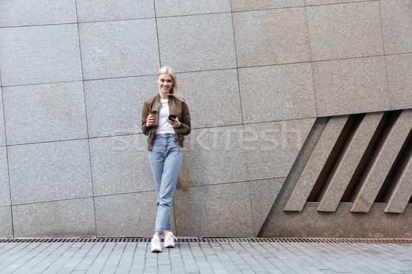 выстрел Кубок кофе смартфон молодые Сток-фото © deandrobot