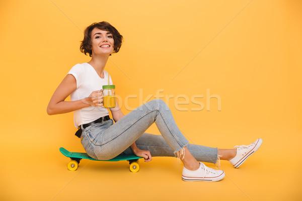 портрет довольно Cute девушки сидят скейтборде Сток-фото © deandrobot