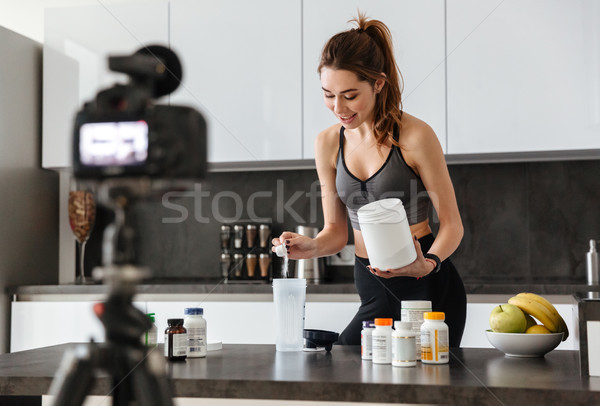 Fit healthy young girl recording her video blog episode Stock photo © deandrobot