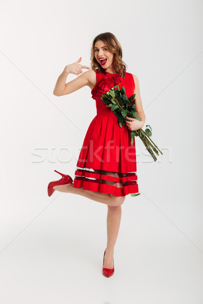 Full length portrait of a delighted young woman Stock photo © deandrobot