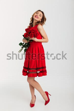 Full length portrait of a satisfied young woman Stock photo © deandrobot
