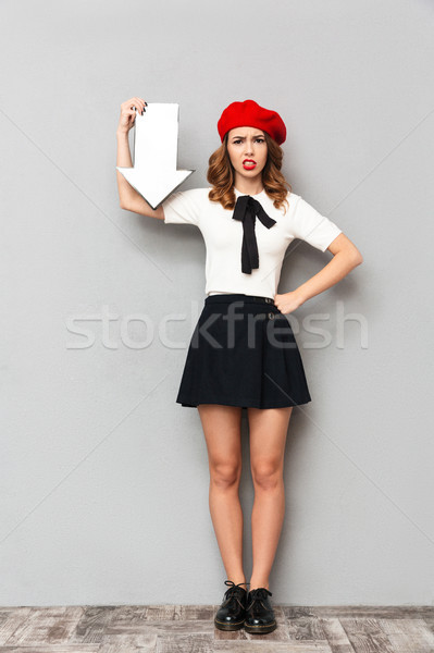Full length portrait of a disappointed schoolgirl Stock photo © deandrobot