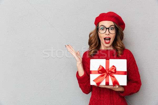 Portrait of an amazed woman dressed in red sweater Stock photo © deandrobot