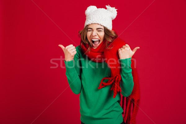 Felice urlando bruna donna maglione divertente Foto d'archivio © deandrobot