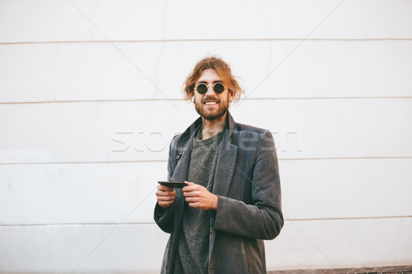 Portrait of a happy bearded man wearing sunglasses Stock photo © deandrobot