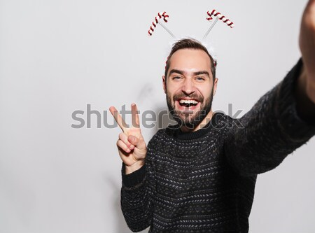Laughing woman with red lips standing isolated Stock photo © deandrobot