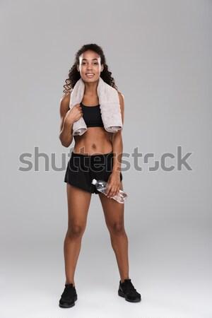 Egészséges fiatal mozgássérült sportoló áll izolált Stock fotó © deandrobot