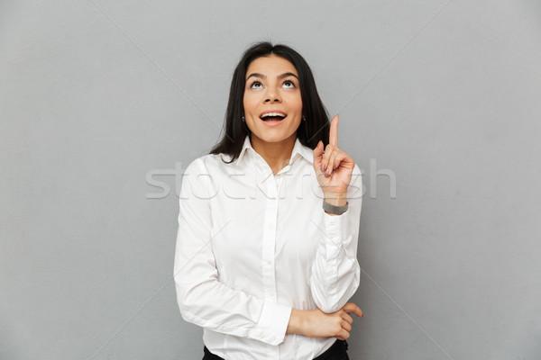 Retrato excitado mujer blanco camisa Foto stock © deandrobot