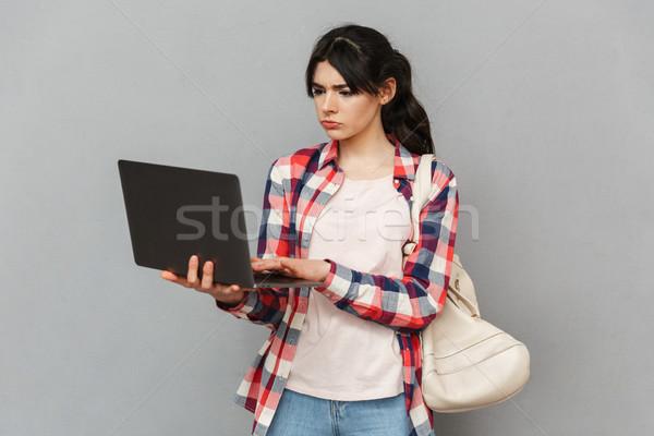 Stock fotó: Szomorú · elégedetlen · fiatal · hölgy · diák · laptopot · használ