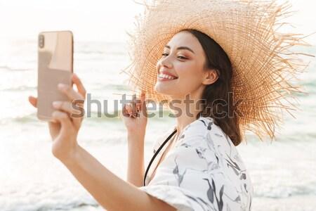 Fotó szőke nő 20-as évek mosolyog elvesz napfelkelte Stock fotó © deandrobot
