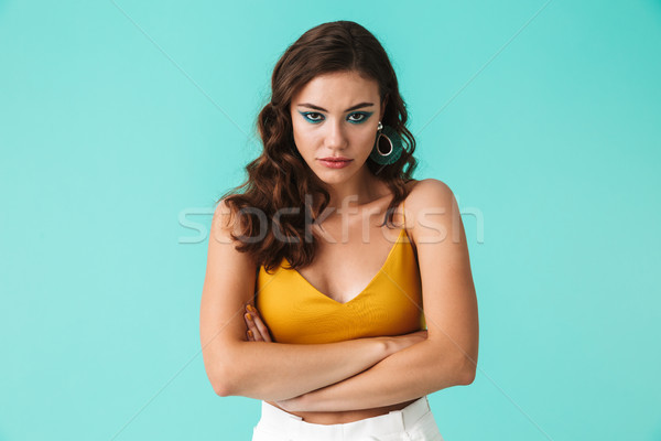 Image of disappointed woman 20s wearing fashion makeup and earri Stock photo © deandrobot