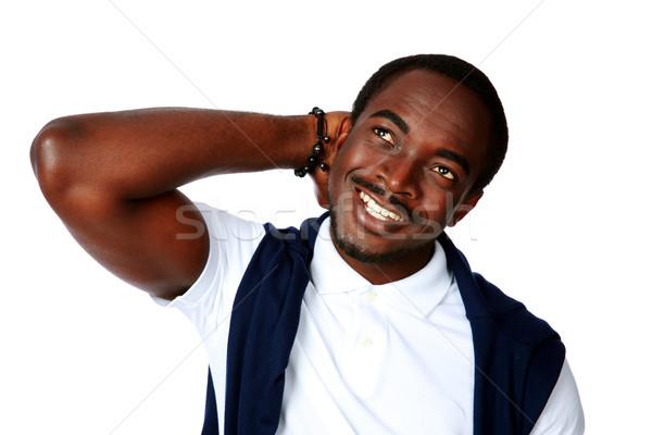 Boldog figyelmes afrikai férfi felfelé néz fehér Stock fotó © deandrobot