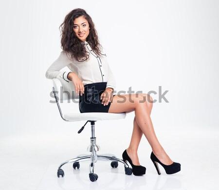 Gülümseyen kadın oturma ofis koltuğu gri ofis Stok fotoğraf © deandrobot