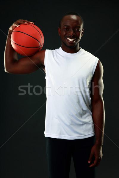 Felice african american nero basket fitness Foto d'archivio © deandrobot