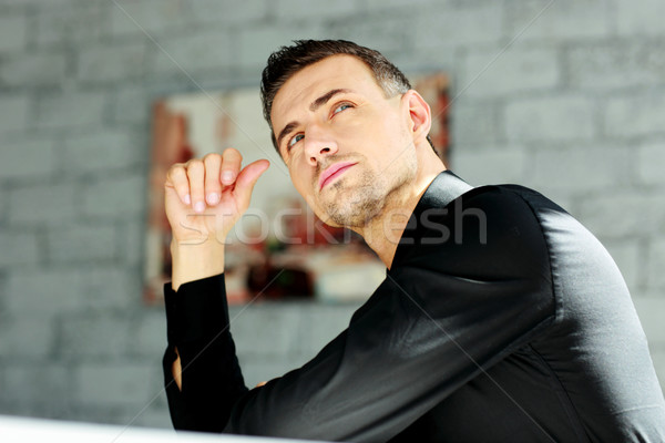 Portrait of a thoughtful businessman at office Stock photo © deandrobot