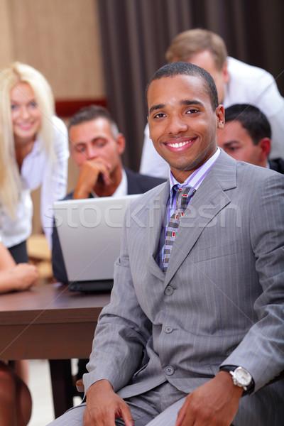 Boldog üzletember csapat dolgozik mögött iroda Stock fotó © deandrobot