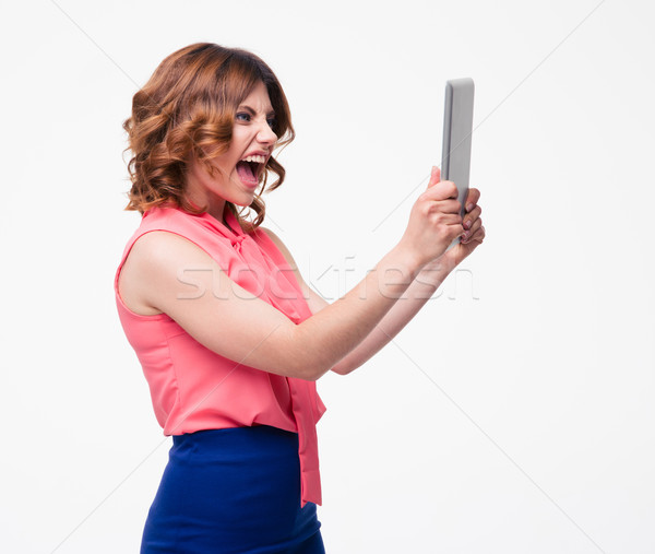Angry woman shouting on tablet computer Stock photo © deandrobot