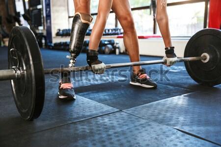 Izmos férfi fitt nő edzés bogrács Stock fotó © deandrobot