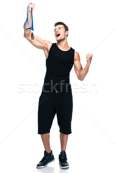 Sucess sports man holding winner medal Stock photo © deandrobot