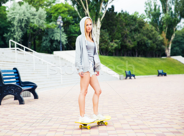 Young girl skateboarding Stock photo © deandrobot