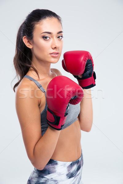Portrait of a beautiful female boxer Stock photo © deandrobot