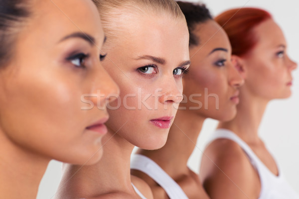 Four woman standing in a row  Stock photo © deandrobot