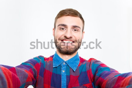 Selfie photo of happy smiling bearded guy in plaid shirt Stock photo © deandrobot