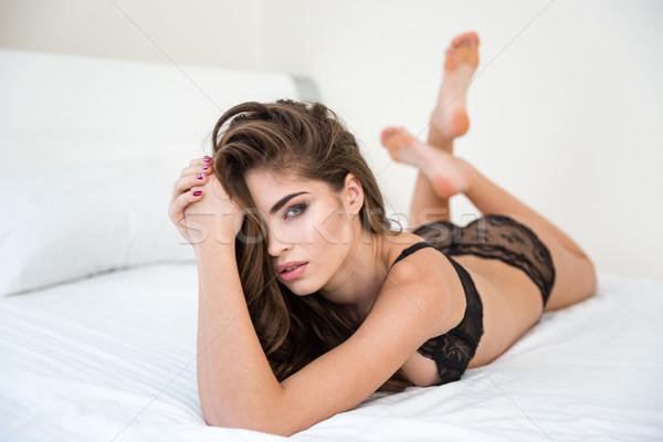 Mulher lingerie cabelos longos cama retrato mulher sexy Foto stock © deandrobot
