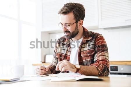 Yakışıklı konsantre adam çalışma planı cetvel Stok fotoğraf © deandrobot